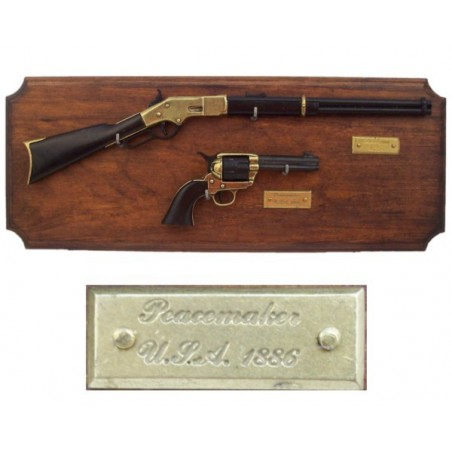 Miniatures of rifle and revolver on wooden board (39cm)