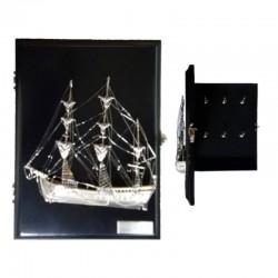 Keyhanger with silvery brass sailboat in locker