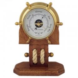 Brass rudder wheel with barometer on block 28x21x10cm